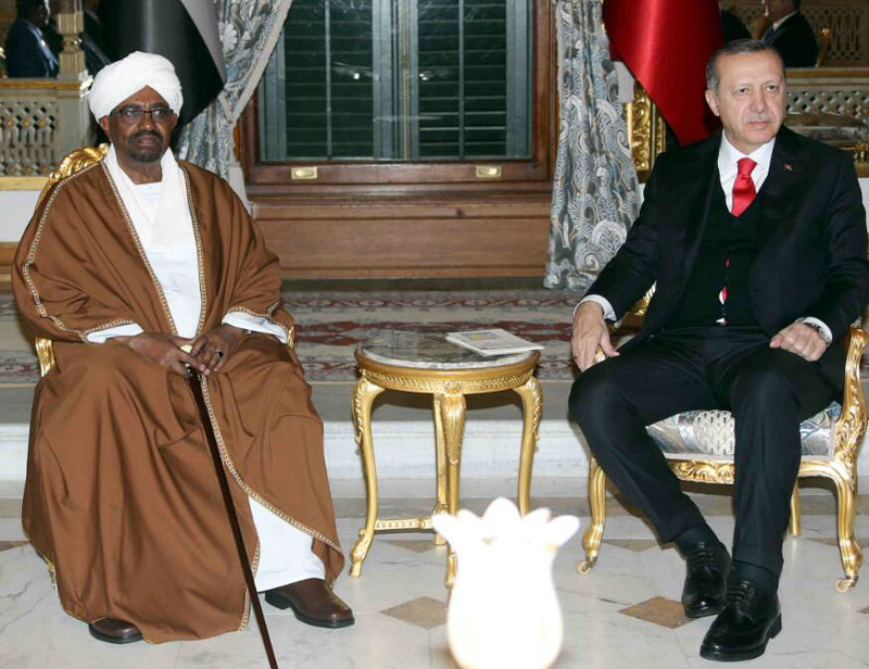 President Bashir returns home at the end of OIC Turkey Summit